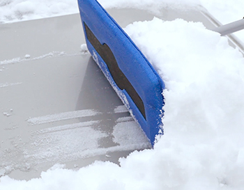 Snow Joe® Snow Broom used on the car hood